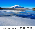 mt fuji  in the early morning.... | Shutterstock . vector #1235910892