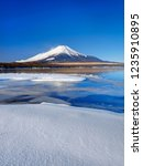 mt fuji  in the early morning.... | Shutterstock . vector #1235910895