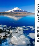 mt fuji  in the early morning.... | Shutterstock . vector #1235910928