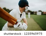 cricketer on the field in action | Shutterstock . vector #1235965975