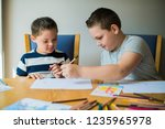 cute brothers drawing at a table | Shutterstock . vector #1235965978