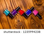 different nail polishes on...   Shutterstock . vector #1235994238