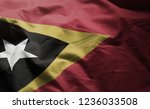 east timor flag rumpled close... | Shutterstock . vector #1236033508