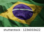 brazil flag rumpled close up  | Shutterstock . vector #1236033622