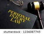 personal injury law book and a... | Shutterstock . vector #1236087745