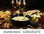 gourmet swiss fondue dinner on... | Shutterstock . vector #1236101272