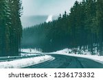 empty snowed road in mountains... | Shutterstock . vector #1236173332