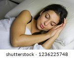 young woman sleeping in bed at... | Shutterstock . vector #1236225748
