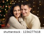 young couple is in christmas... | Shutterstock . vector #1236277618