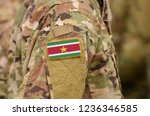 suriname flag on soldiers arm.... | Shutterstock . vector #1236346585