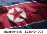 north korea flag rumpled close... | Shutterstock . vector #1236404008