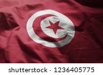 tunisia flag rumpled close up  | Shutterstock . vector #1236405775