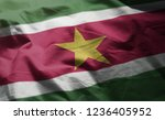 suriname flag rumpled close up  | Shutterstock . vector #1236405952