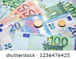 Euro Coins And Banknotes On Th...