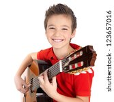 Happy boy is playing on acoustic guitar - isolated on white background - stock photo