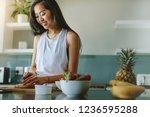 woman preparing healthy salad... | Shutterstock . vector #1236595288