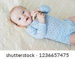 adorable baby girl lying on bed ...   Shutterstock . vector #1236657475