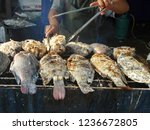 man grilling fish on barbecue... | Shutterstock . vector #1236672805
