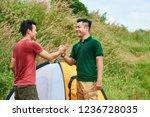 happy friends shaking hands... | Shutterstock . vector #1236728035
