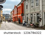 Small photo of Porvoo, Finland - September 14 2018: Tourists and local Finns walk past shops along the cobbled streets of the medieval old town section of Porvoo, Finland.