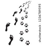 footprints of bare feet and...   Shutterstock .eps vector #1236789595