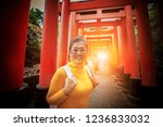asian tourist toothy smiling... | Shutterstock . vector #1236833032
