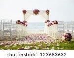 wedding setting on the beach. | Shutterstock . vector #123683632