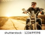 biker man sits on a bike | Shutterstock . vector #123699598