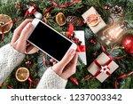 female hands holding mobile... | Shutterstock . vector #1237003342