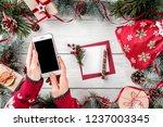 female hands holding mobile... | Shutterstock . vector #1237003345