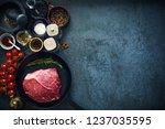 raw marbled beef steak on cast...   Shutterstock . vector #1237035595