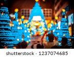 people in christmas lighting...   Shutterstock . vector #1237074685