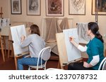 Small photo of Russia, Surgut, October 17, 2018: Art Studio for adults named after V.Gorda. Adult students sit at easels, learn to draw.