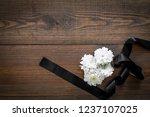 funeral symbols. white flower... | Shutterstock . vector #1237107025