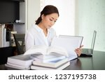 asian women student smiling and ...   Shutterstock . vector #1237195738