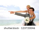 honeymoon piggyback ride on the ... | Shutterstock . vector #123720046
