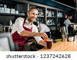 smiling barman decorating... | Shutterstock . vector #1237242628