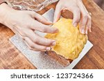 Christmas cake icing decorated by hands - stock photo