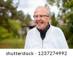 happy senior man with... | Shutterstock . vector #1237274992