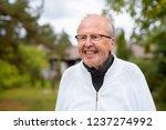 happy senior man with... | Shutterstock . vector #1237274992