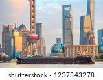 barge by sunset shanghai... | Shutterstock . vector #1237343278