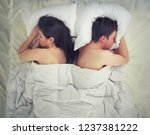 a couple lying in bed | Shutterstock . vector #1237381222