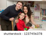 happy family and daughter are...   Shutterstock . vector #1237456378