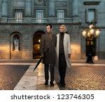 Elegant Couple In Coats Against ...