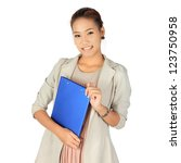young business woman holds a... | Shutterstock . vector #123750958