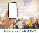 hand holding phone in market... | Shutterstock . vector #1237534522