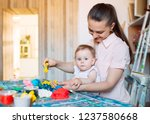 mother and daughter playing... | Shutterstock . vector #1237580668