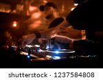 dj mixes the track in the... | Shutterstock . vector #1237584808
