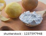 potato starch in a wooden spoon....   Shutterstock . vector #1237597948