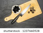 chopping black olives step.... | Shutterstock . vector #1237660528